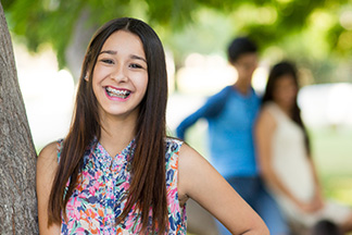 Girl smiling with braces.